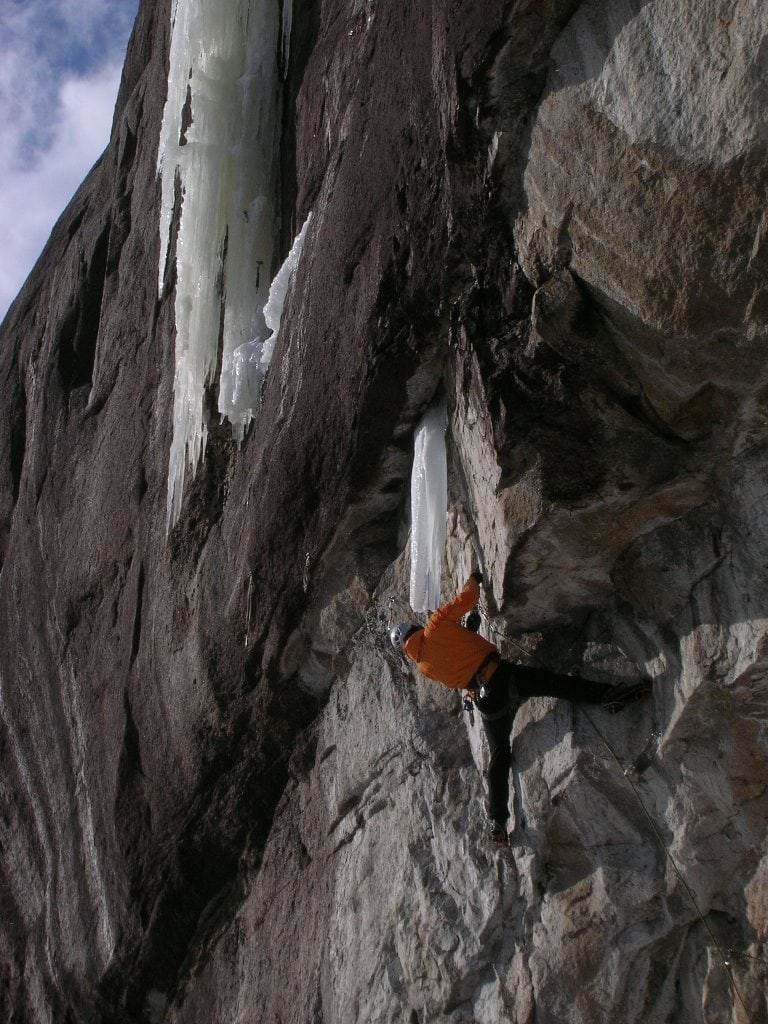 Kevin Mahoney working the 100' of M9 drytooling up to the base of the ice.