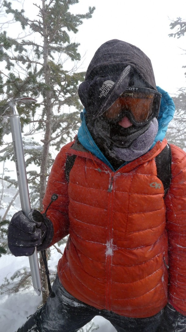 Mary Taylor getting ready for the ferocious winds above tree-line on Mt Washington.