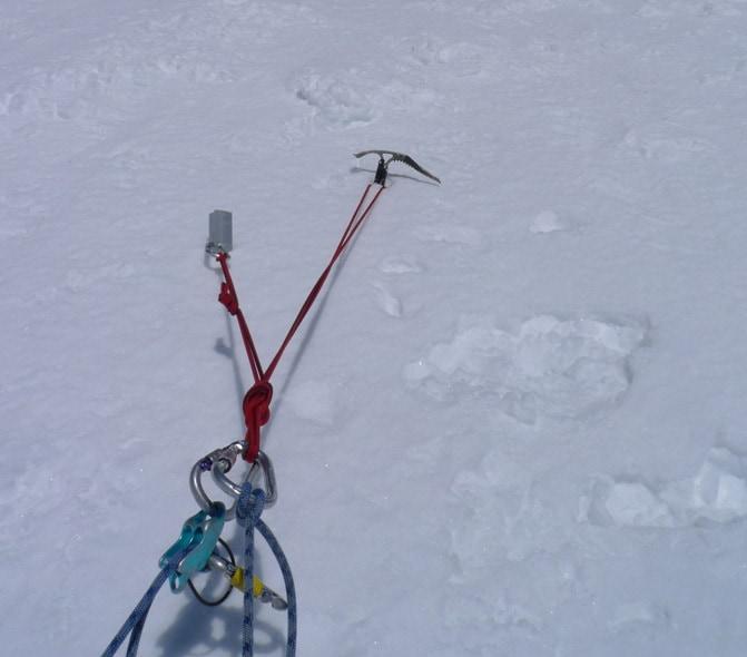 Snow anchor in hard snow in Tuckerman Ravine.
