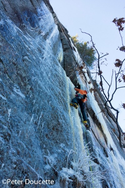 Bayard on a winter ascent of Lichen it a Lot. Cathedral Ledge. Photo by Peter Doucette.