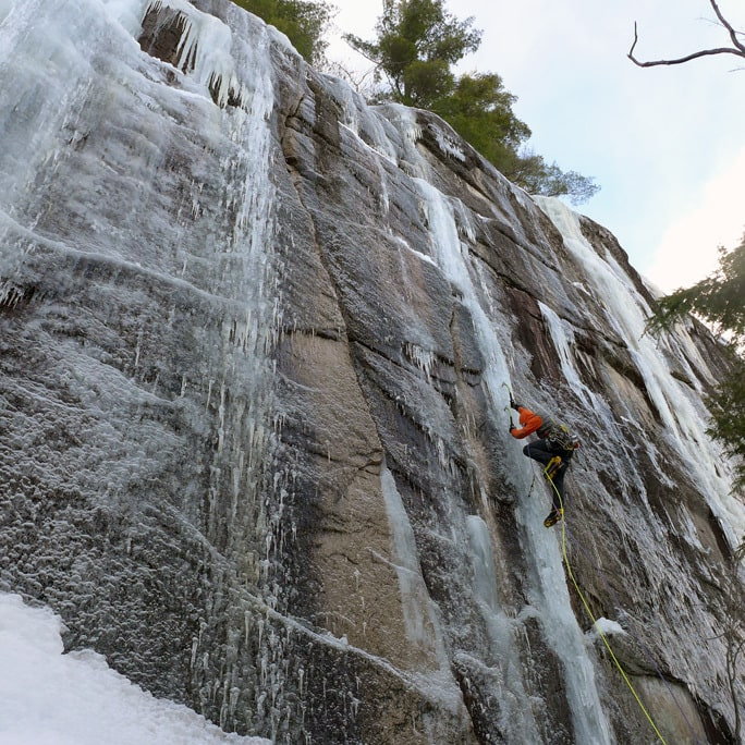 Bayard climbing ice on the Barber Wall, Cathedral Ledge. Elliot Gaddy photo.